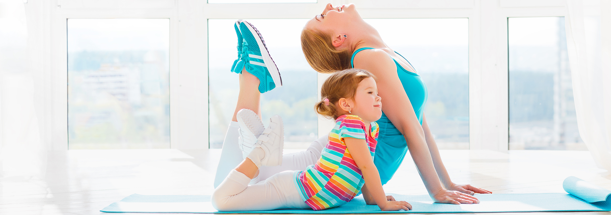 Mom and child practicing yoga