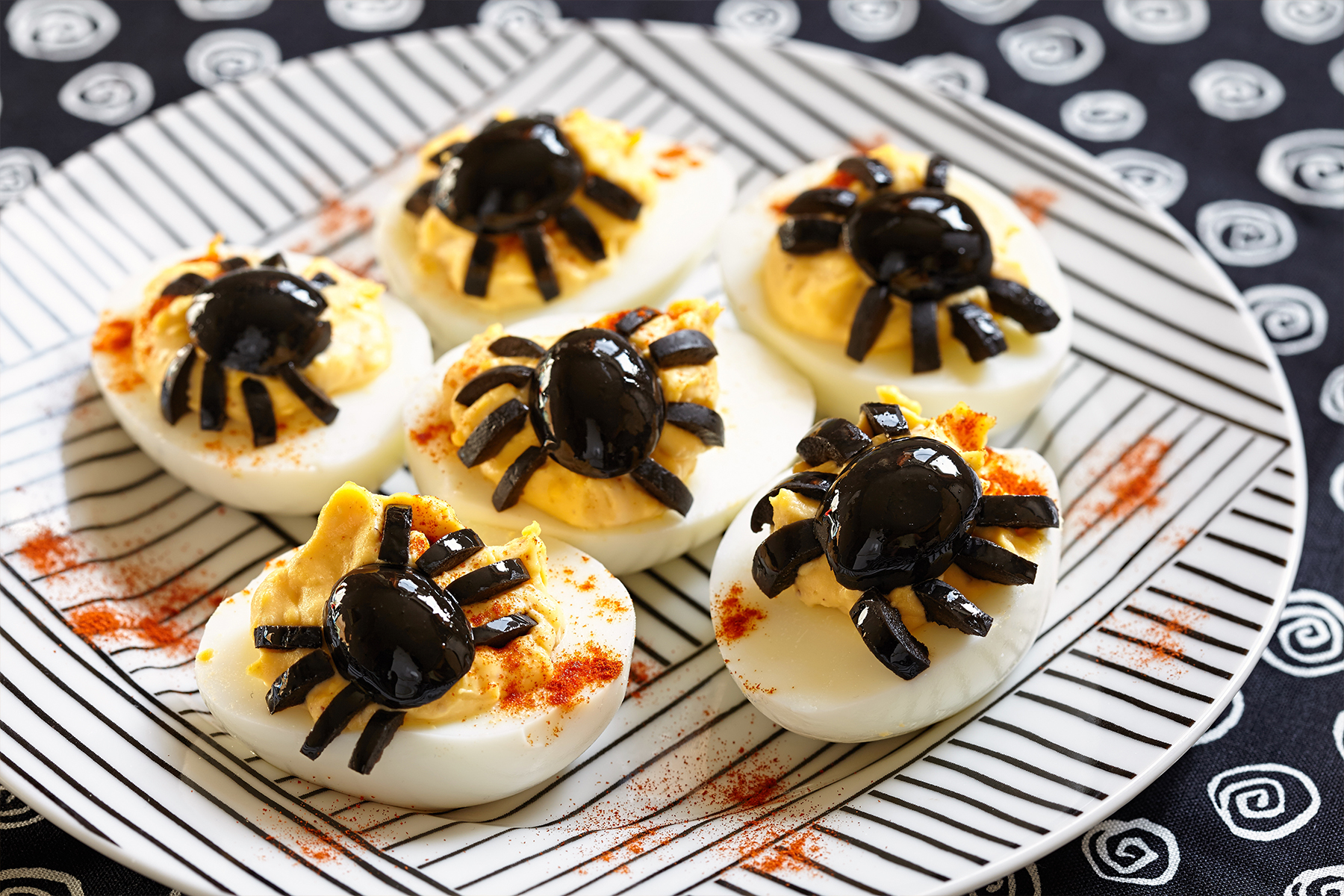 Devilled eggs with olive spiders