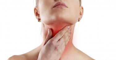 Woman holding thyroid