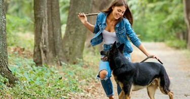 Woman Playfully Walking Dog
